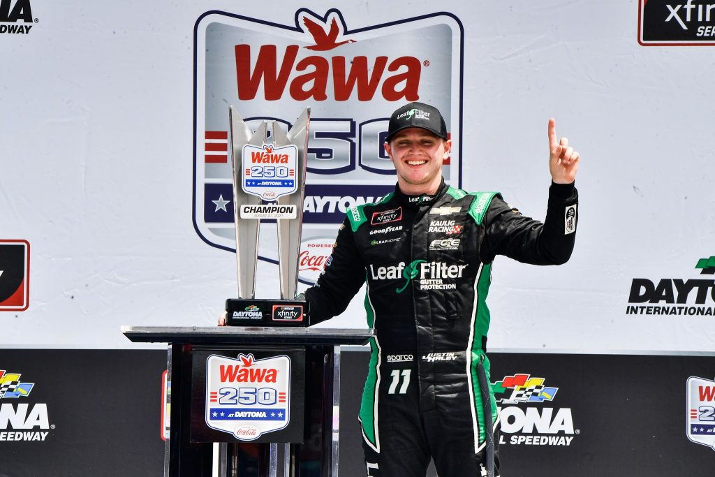 Justin Haley poses with his trophy in the Ruoff Mortgage Victory Lane after winning the Wawa 250 at Daytona International Speedway Saturday, August 28, 2021. Photo: Harry Catiblanco/Florida National News.