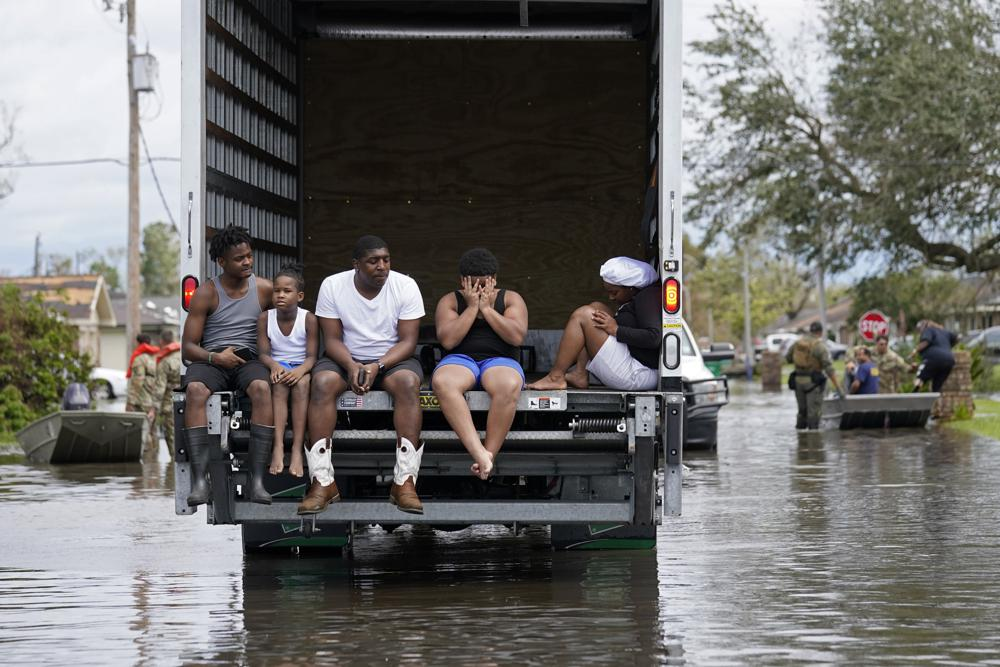 People are evacuated from floodwaters in the aftermath of Hurricane Ida in LaPlace, La., Monday, Aug. 30, 2021. (AP Photo/Gerald Herbert)
