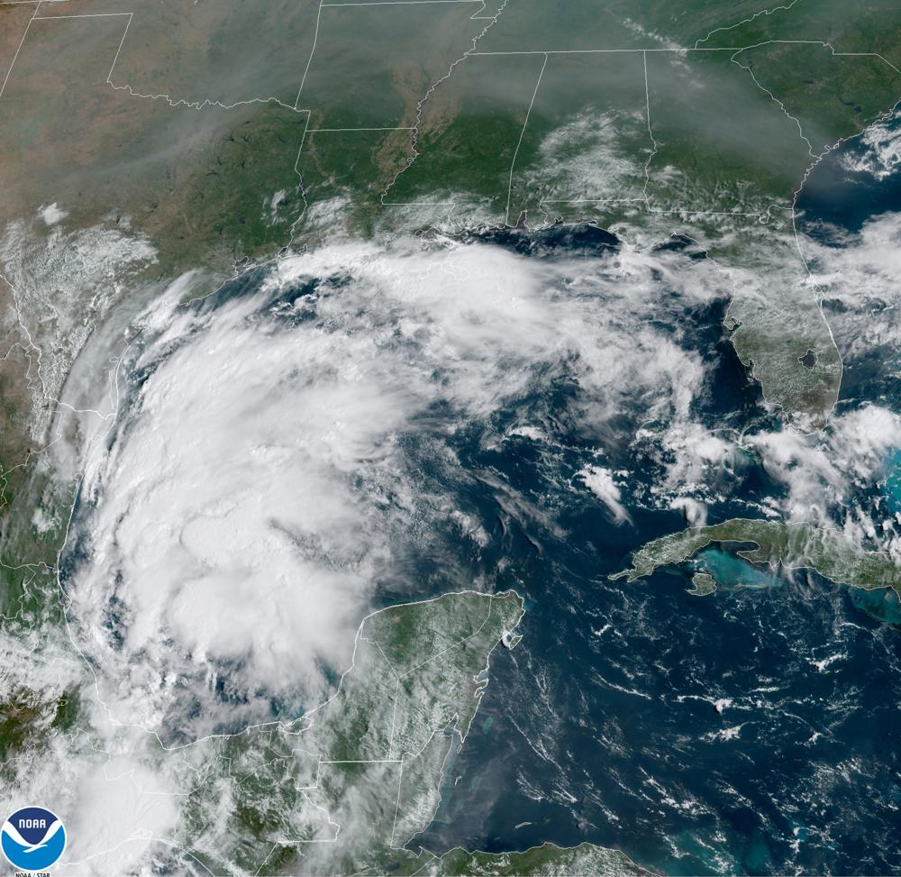This satellite image provided by NOAA shows Tropical Storm Nicholas in the Gulf of Mexico on Sunday, Sept. 12, 2021. Tropical storm warnings have been issued for coastal Texas and the northeast coast of Mexico. Nicholas is expected to produce storm total rainfall of 5 to 10 inches, with isolated maximum amounts of 15 inches, across portions of coastal Texas into southwest Louisiana Sunday, Sept. 12 through midweek. (NOAA via AP)