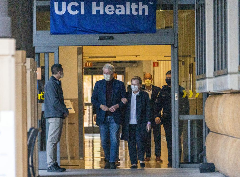 Former President Bill Clinton and former U.S. Secretary of State Hillary Clinton leave the University of California Irvine Medical Center in Orange, Calif., Sunday, Oct. 17, 2021. He was released after being treated for an infection and will head home to New York to continue his recovery, a spokesman said. (AP Photo/Damian Dovarganes)