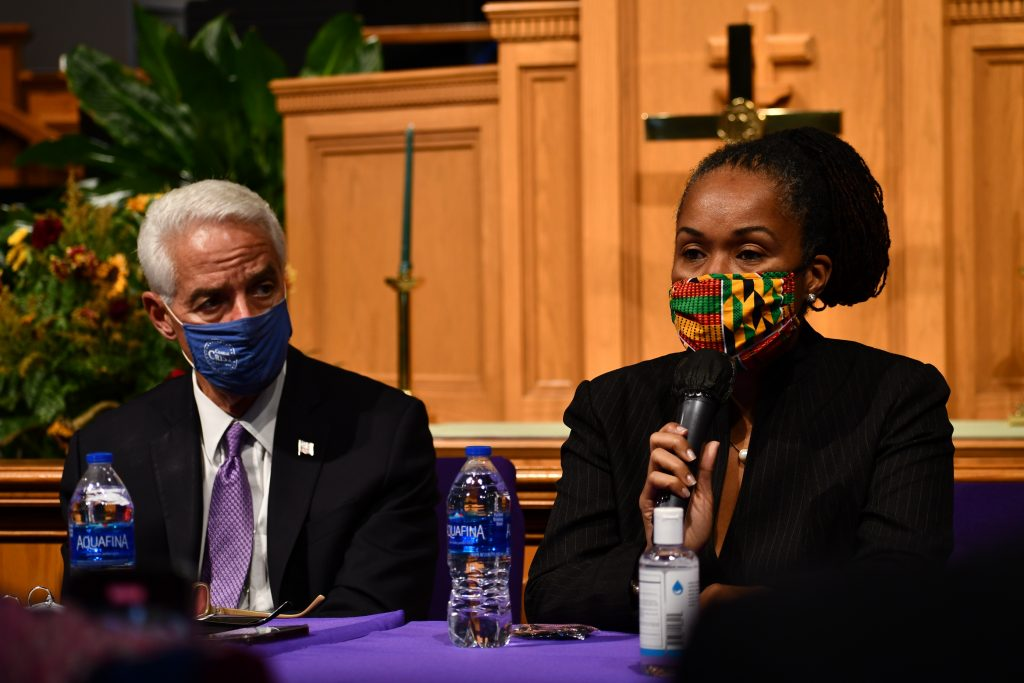 US Representative Charlie Crist listens as State Attorney Monique Worrell speaks during Crist's Justice For All roundtable in Orlando Monday, October 11, 2021. Credit: Juan Carlo Rodriguez/Florida National News.