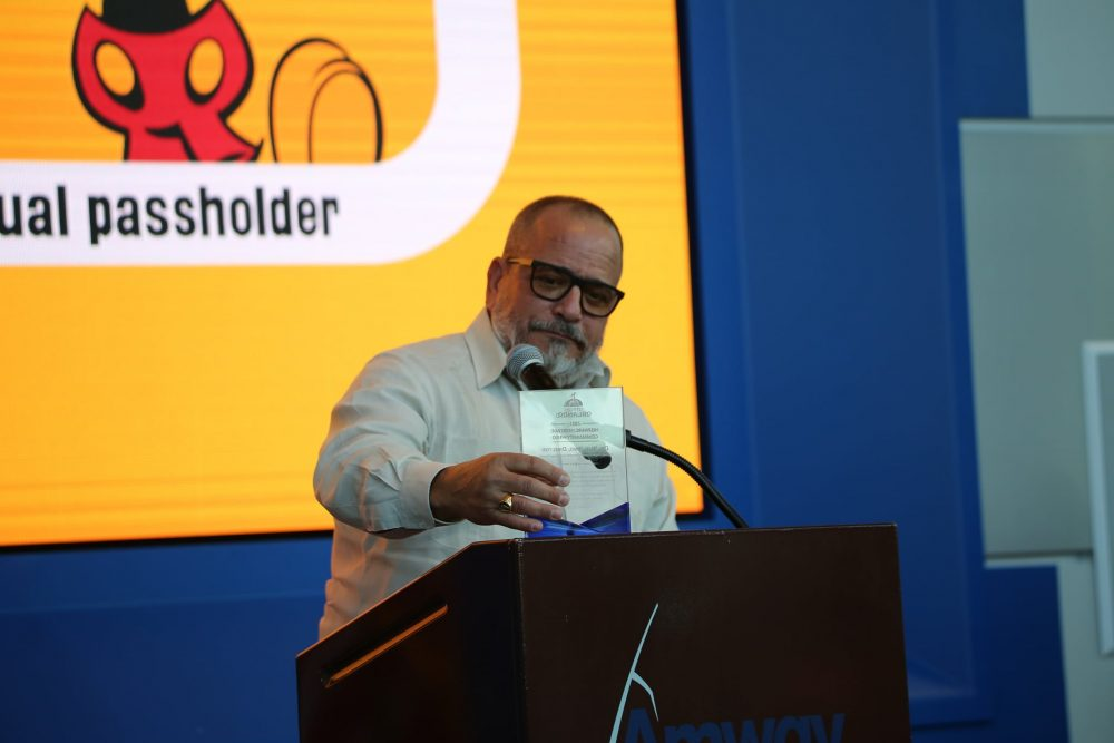 Dr. Raul Pino receives the City of Orlando's Community Hero Award for his consistent COVID-19 updates during Orange County Mayor Jerry Demings' coronavirus press updates during the City of Orlando's Hispanic Heritage Month Celebration at Amway Center in downtown Orlando Tuesday, October 14, 2021. Photo: Willie David/Florida National News.