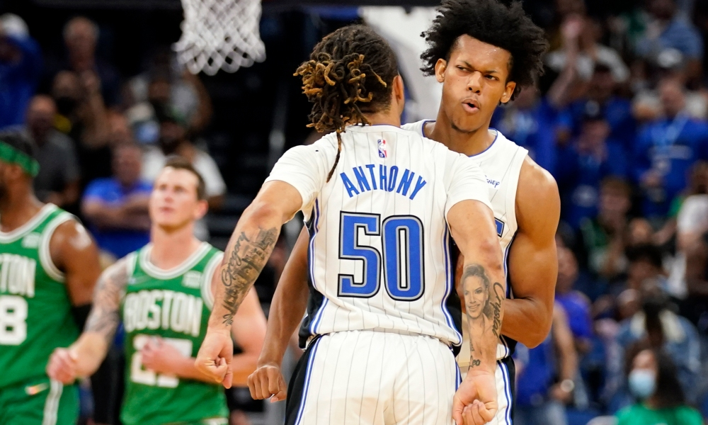 Cole Anthony (#50) celebrates with Jeff Dowtin after Downtin lands the closer shot at the end of the Orlando Magic's preseason home against the Boston Celtics at Amway Center Wednesday, October 13, 2021. Photo: John Raoux/AP.