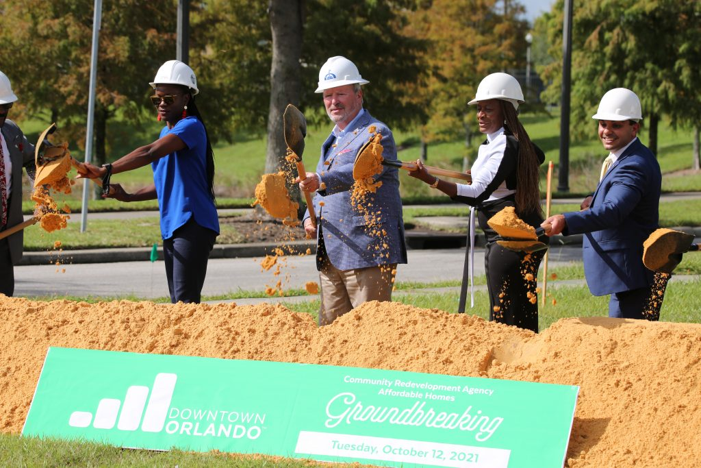 Orlando Mayor Buddy Dyer (2nd from left), Orlando District 5 Commissioner Regina I. Hill (center), developers and community leaders break ground on the development of what will be eight new home in Parramore in Downtown Orlando Tuesday, October 12, 2021. Photo: J. Willie David III/Florida National News.