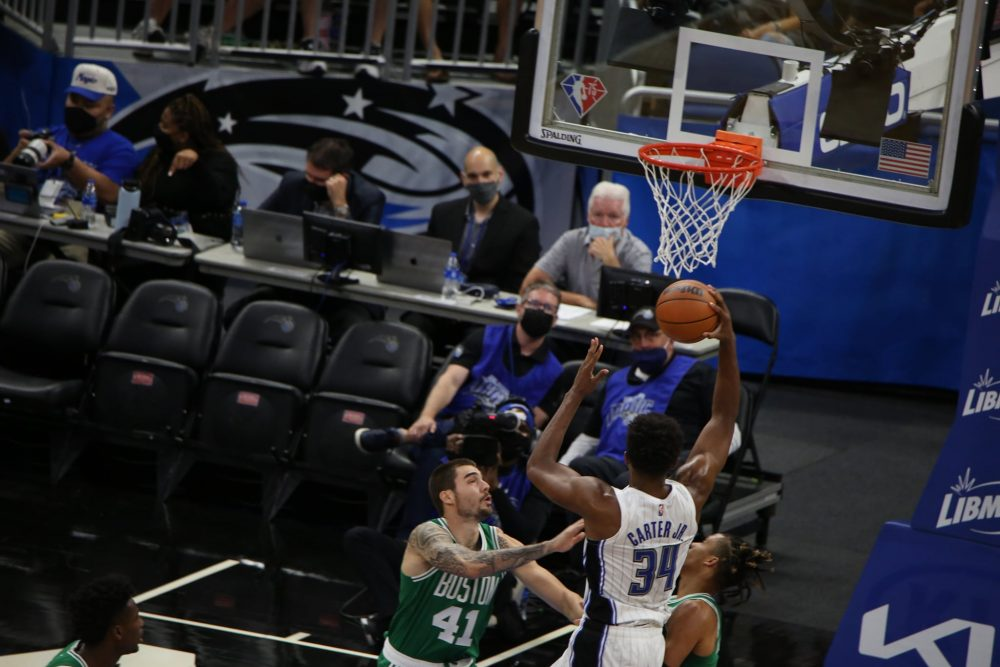 Wendell Carter Jr. (#34) takes the ball to the net during Orlando Magic's preseason home game against Boston Celtics at Amway Center Wednesday, October 13, 2021. Photo: Willie David/Florida National News.